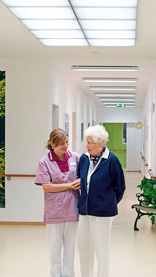 The corridor of Elderly Care Home illuminated by Philips Lighting